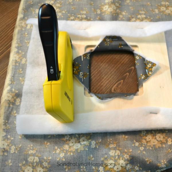 DIY Fabric Photo Frame - stapling to board- 736x736 - Sondra Lyn at Home.com