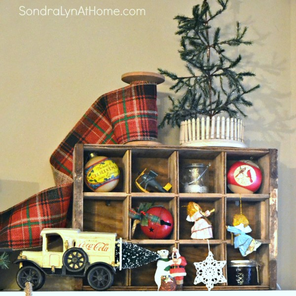 Family Room at Christmastime - mantel cola truck detail - All Through the House Tour - Sondra Lyn at Home