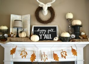 Fall Mantel featuring deer mount, pumpkins, chalkboard tray and fall leaf banner -- Sondra Lyn at Home.com