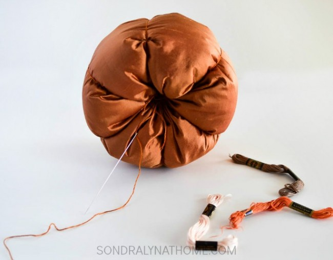 how-to-make-a-fabric-pumpkin-by-sondra-lyn-at-home-com-cinching-the-fabric