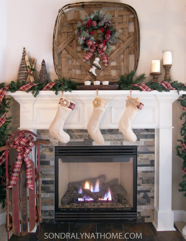 Plaid Tidings Mantel with Sled and tobacco basket and plaid ribbon- Sondra Lyn at Home