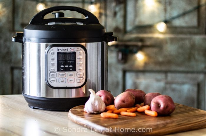 InstantPot on table with potatoes and carrots by Sondra Lyn at Home